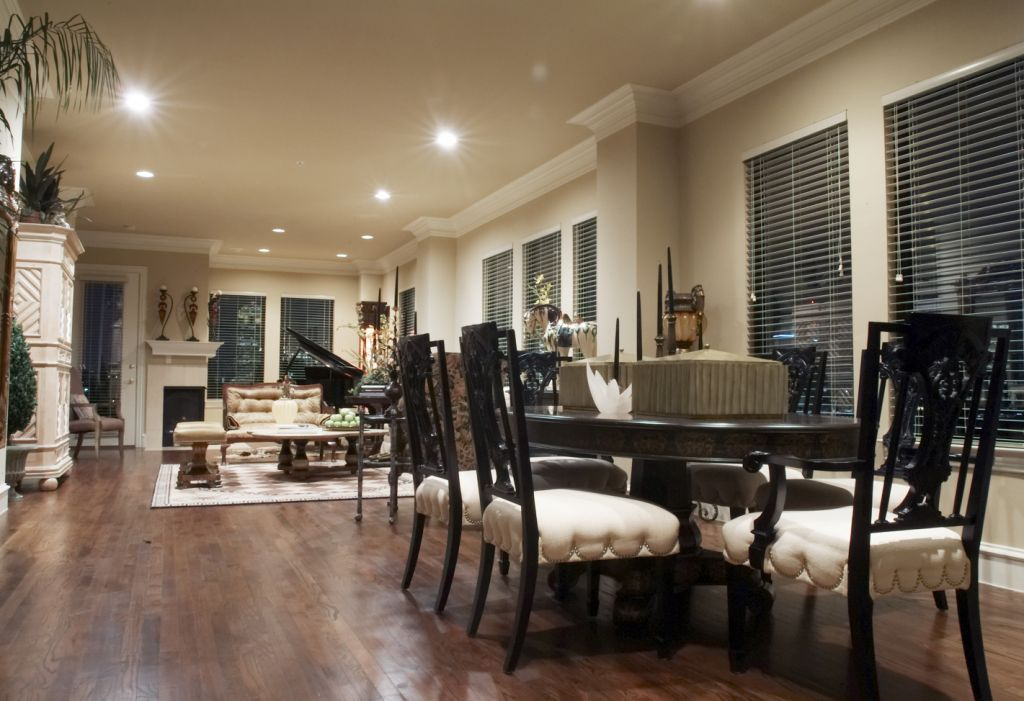 Elegant dining room chairs and hardwood floors at Rienzi at Turtle Creek Apartments in Dallas, TX.