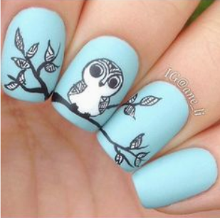 owl nail art on blue