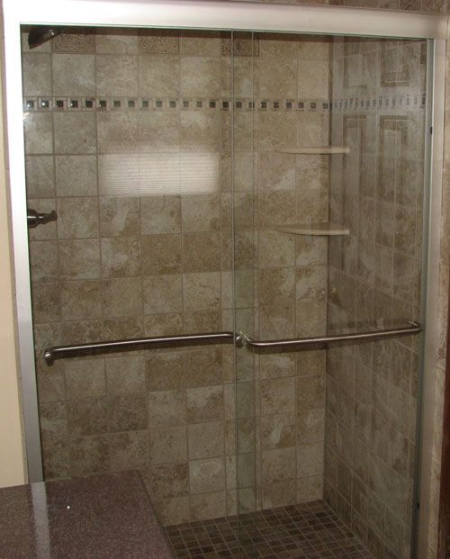 Ceramic Tile Shower With Mosaic Border And Marble Corner
