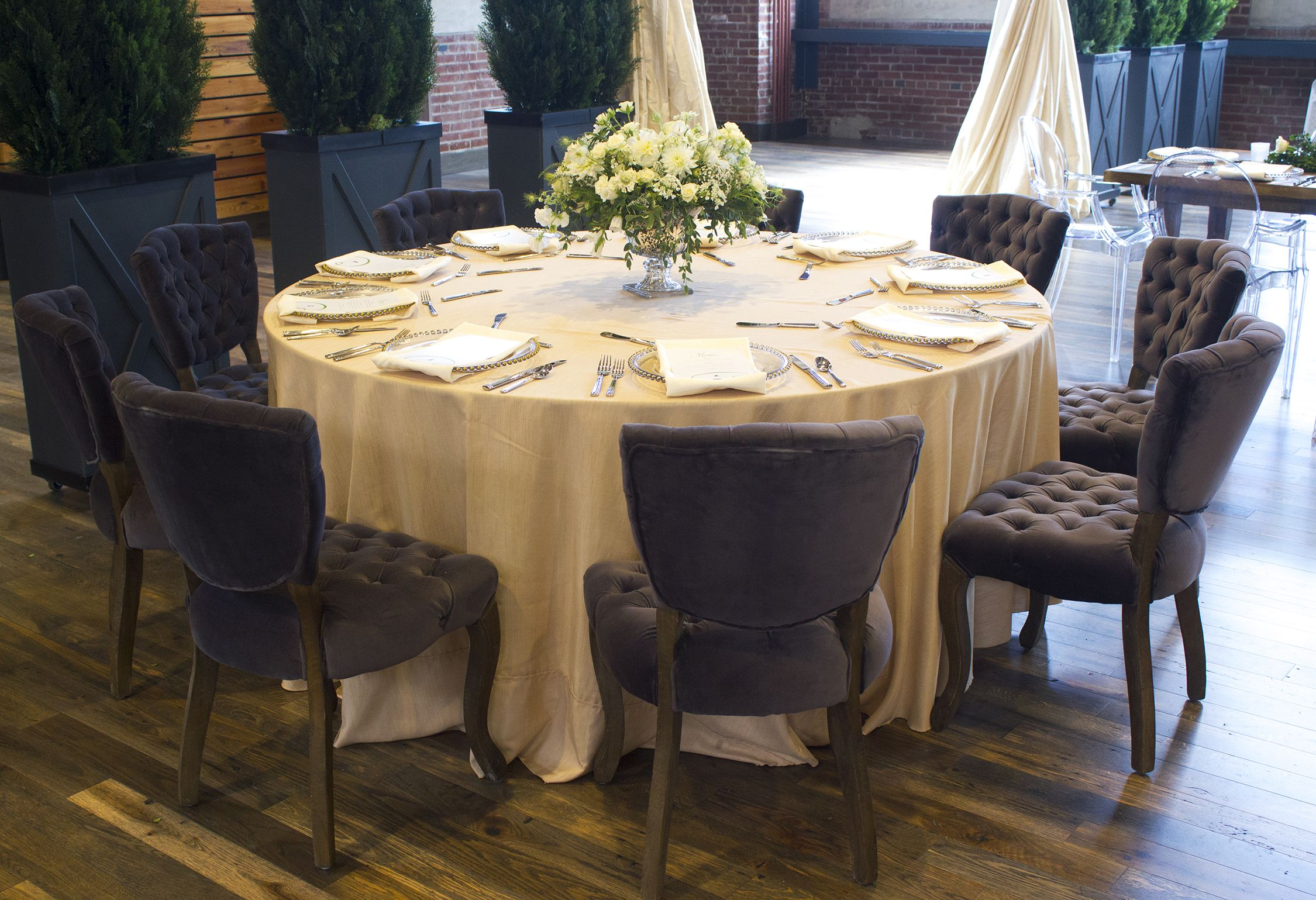 Centerpiece, chairs, linens and other decor provided by