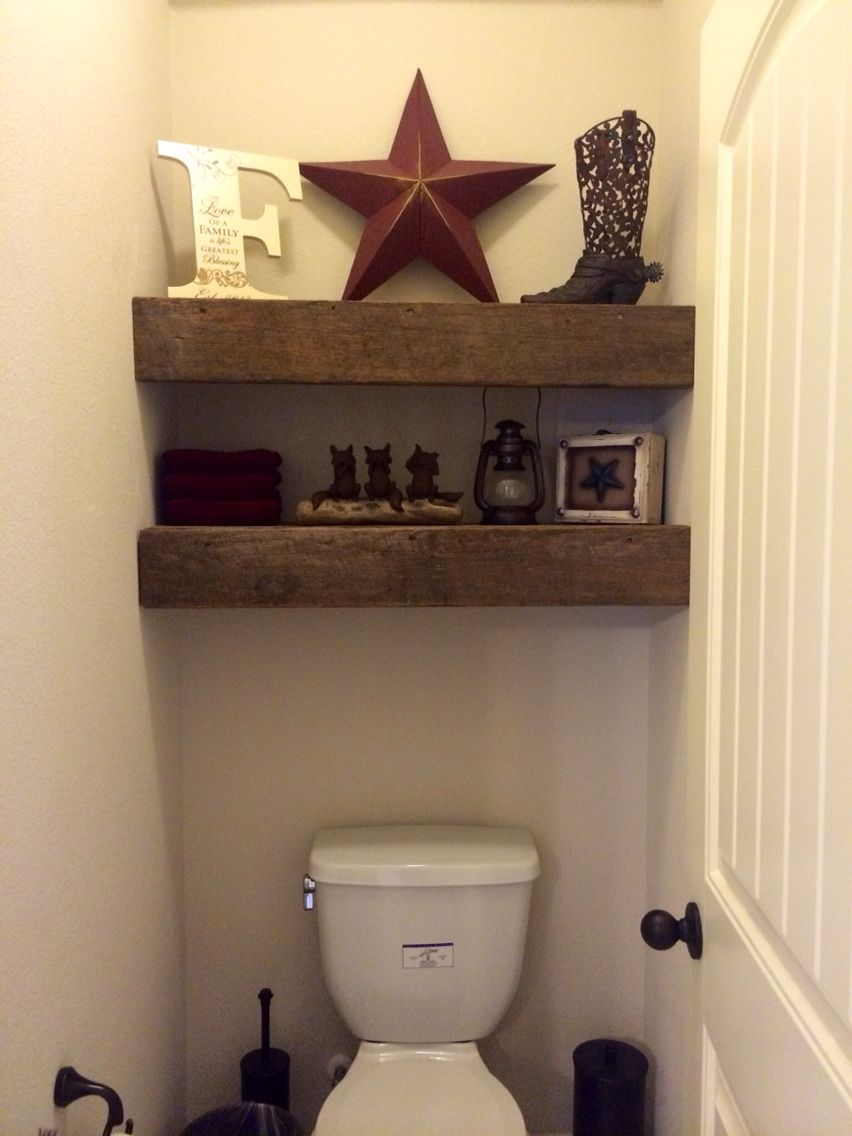 reclaimed wood shelves and western decor for the toilet room in our