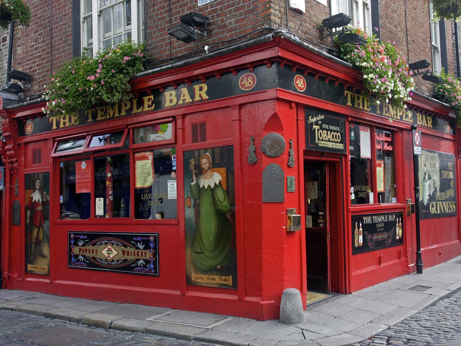 Dublin's The Temple Bar--a must-see for all visitors!  Live entertainment and friendly bartenders come free with the visit :)