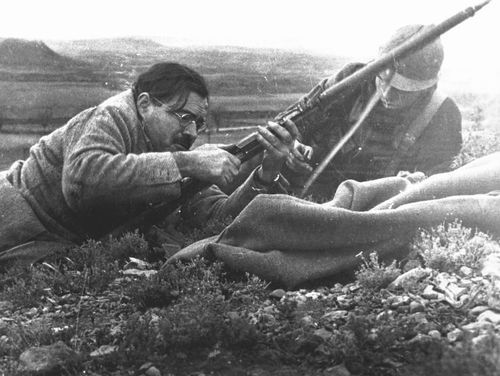 Hemingway in Spain #Robert Capa.