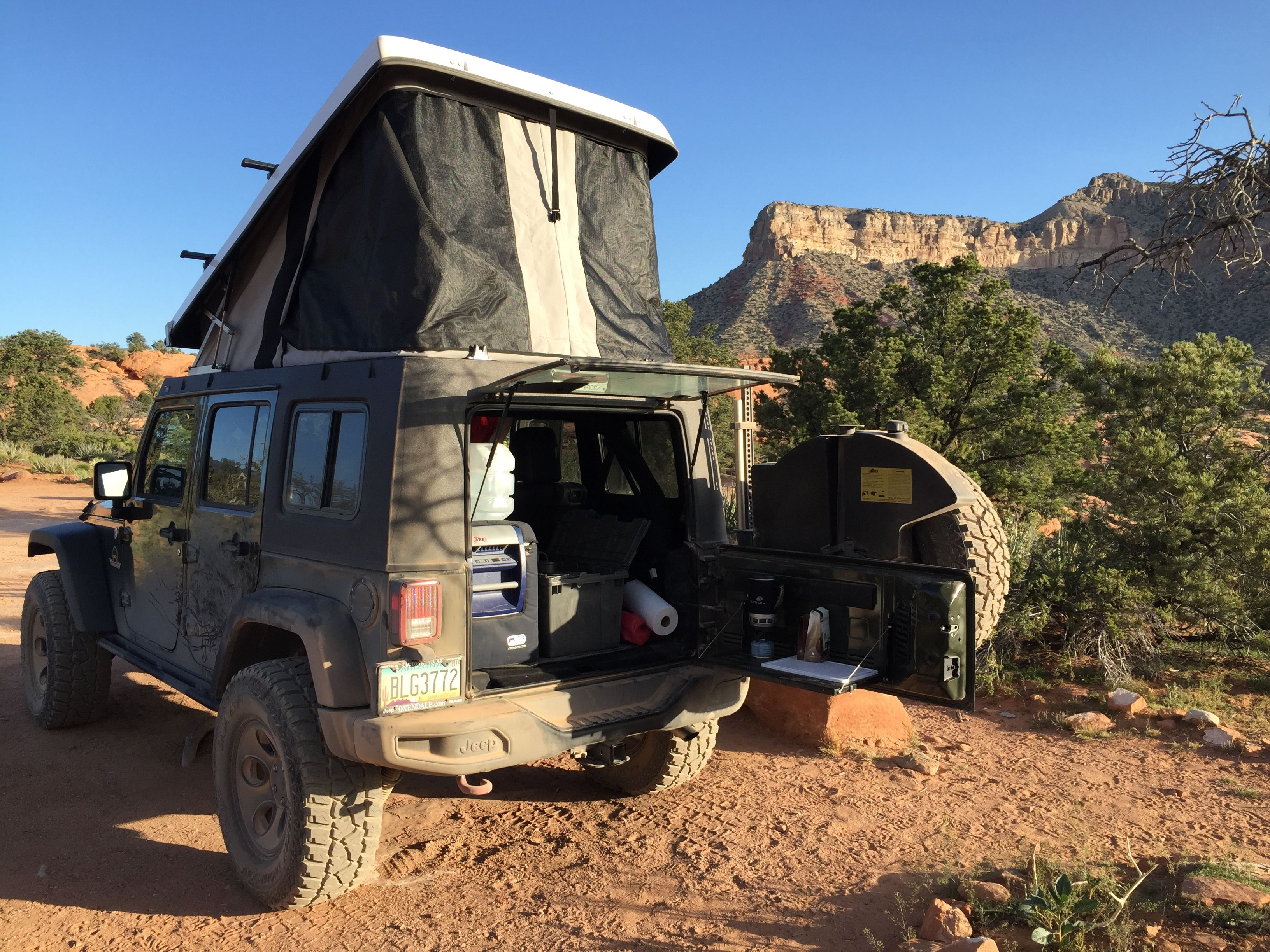 Camping With The Ursa Minor Rooftop Tent On A Jeep Wrangler At Toroweap Az Arb Fridge Teraflex Tailgate Table Jeep Camping Roof Top Tent Jeep Tent