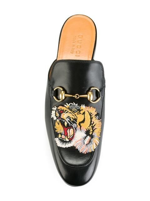 94ebe9a903e7 Shop Gucci tiger Princetown slippers.