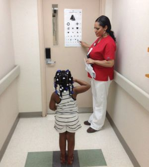 A child receives a vision test at the Wilkerson Pediatric Clinic. It's important for parents to schedule school and sports physicals soon for their children to avoid the late August rush at the Kenner Army Health Clinic.