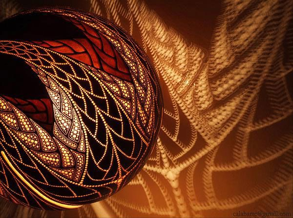 Exceptional Polish Artist Przemek, Also Known As Calabarte, Sculpts Beautiful Patterns  On African Gourds Which Later Become Heads Of His Extraordinary Lamps.