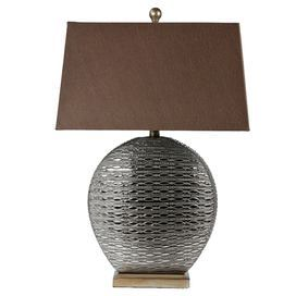 "Ceramic table lamp with a textured metallic base and tapered shade.    Product: Table lampConstruction Material: CeramicColor: Gunmetal and brownFeatures: Antique-inspired designAccommodates: (1) Bulb - not includedDimensions: 27"" H x 12"" W x 6.5"" D"