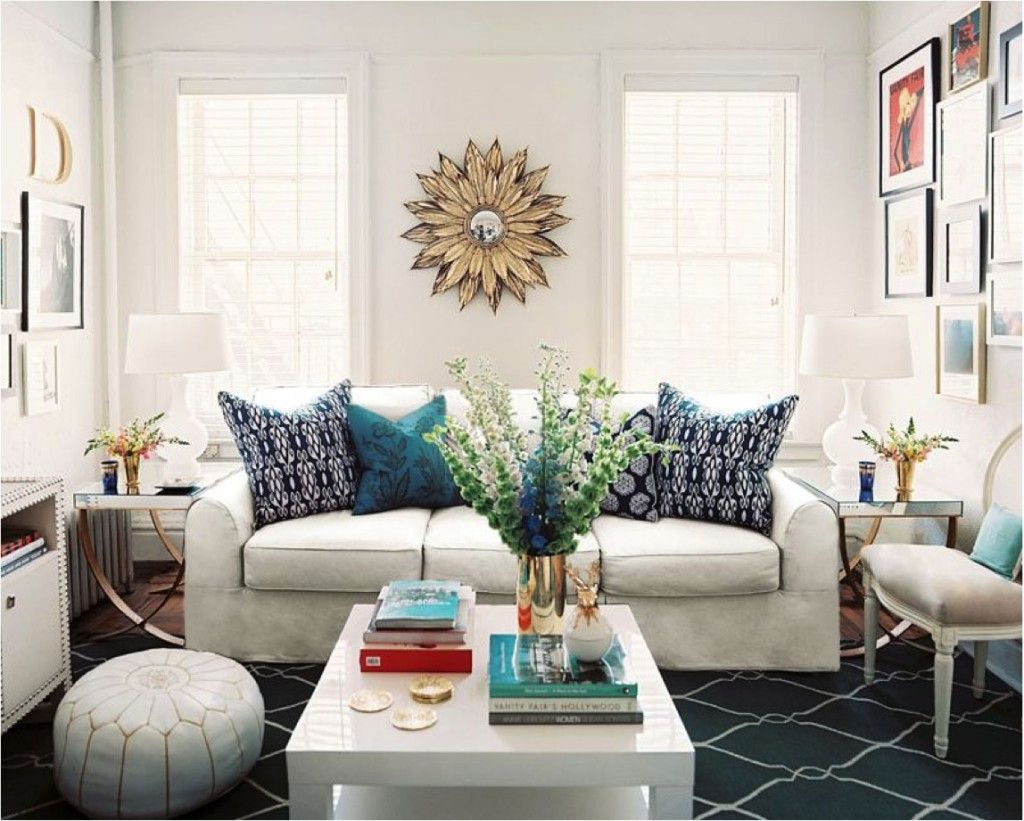 Living Room With White Sofa Navy Fence Print Rug Coffee Table Moroccan Pouf And A Sunburst Mirror