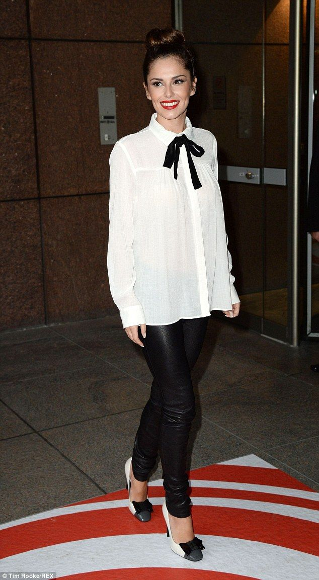Trading up: Cheryl Fernandez-Versini made a glamorous addition to the ICAP charity day in London on Wednesday
