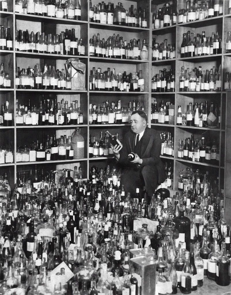Nov. 28, 1923: Liquor and beers were examined by J. W. Quillen, the Bureau of Internal Revenue's chief chemist, who determined that only two of the thousands of bottles in this warehouse weren't terrible moonshine counterfeits. Three years later, Mr. Quillen was quoted in The New York Times warning against future deaths from poisonous alcohol. NY Times