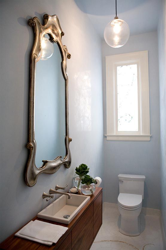 Small Bathroom with sleek cabinets, curvey large mirror - Cifial