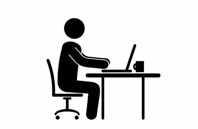 A stick figure sitting at a table working on his laptop with a coffee mug (probably an introvert and INTJ)