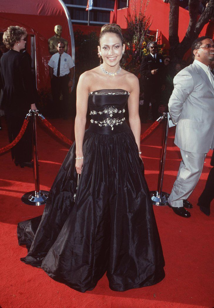 Pin for Later: Every Single Dress Jennifer Lopez Has Worn to the Oscars 1999 Her strapless black Badgley Mischka dress with rhinestone appliqués was definetely eye catching.
