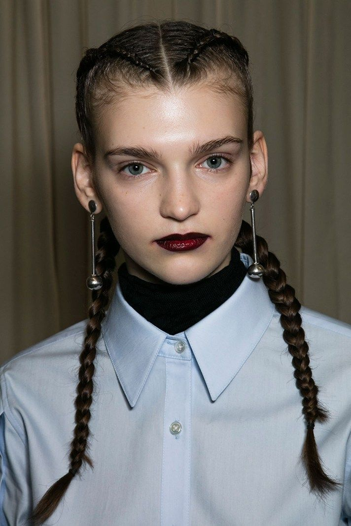 Creatures of the Wind went bold with defined brows; a dark lined lip; and tight, slick pigtail braids.