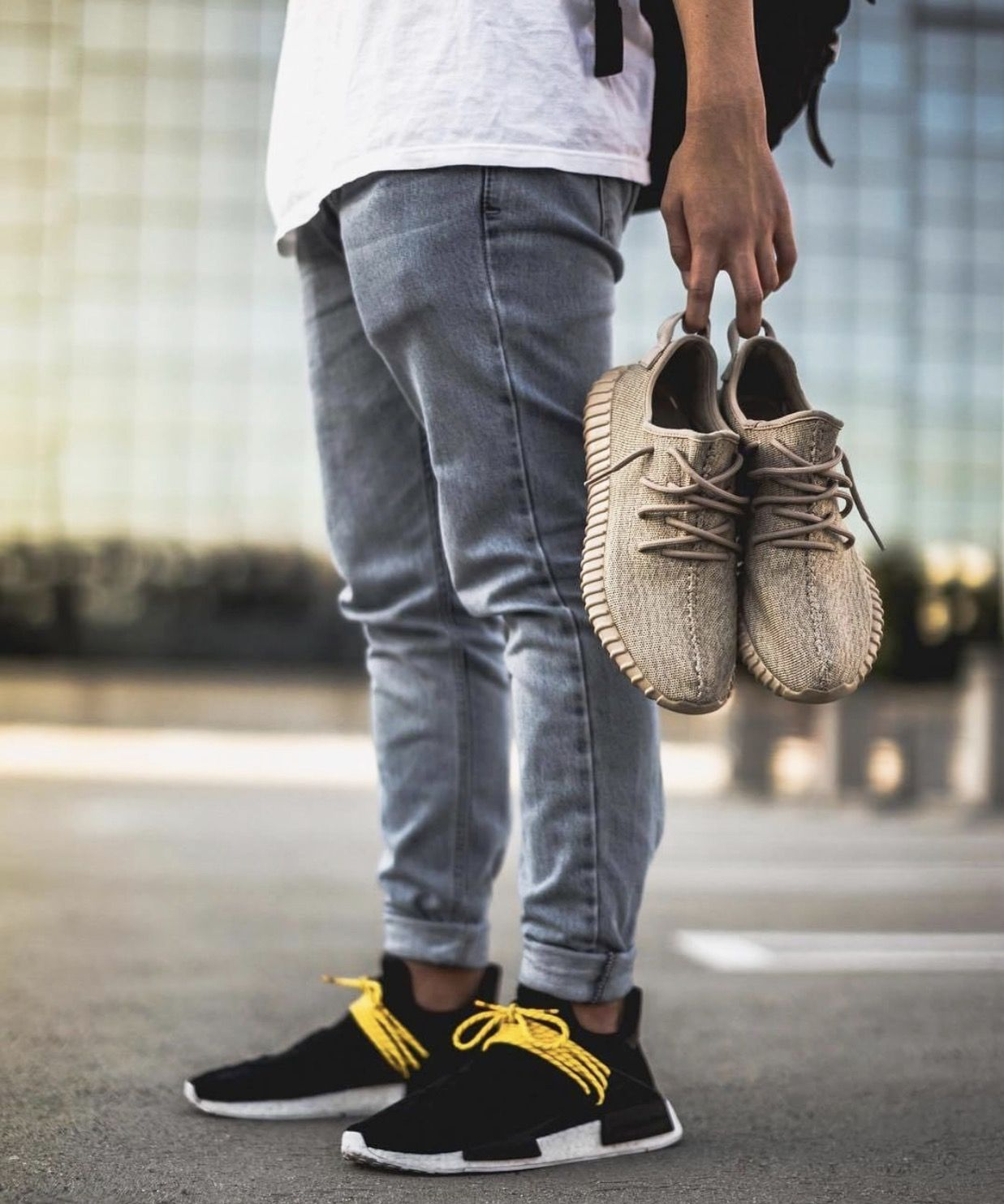 dd3b1d4695a2 On feet   adidas x Pharrell Williams NMD Human Race Blk. In hand  adidas  Yeezy Boost 350 V1