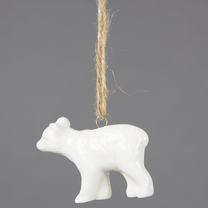 Sass & Belle White Polar Bear Cub Tree Decoration: This sweet Polar Bear Cub Hanging Decoration in white is as cool as he is cute. Made from porcelain and hung with twine, he'll add a touch of style to your tree!