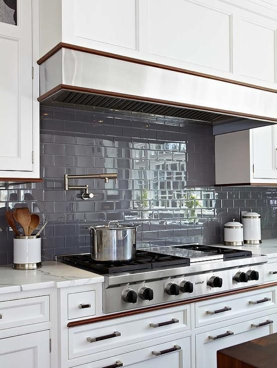 Dark Gray Subway Tiles Continue Throughout A Kitchen Backsplash