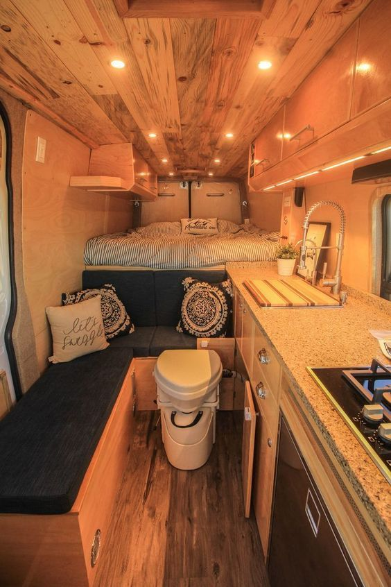 All about that multi-purpose space! Check out more photos of this build in the project gallery of our website. #van #vanlife #toilet #bathroom #kitchen #bedroom #interiors #sprinter #sprintervan #sprinterconversion #vanconversion #convertedvan #travel #roadtrip #vacation #freedomvans