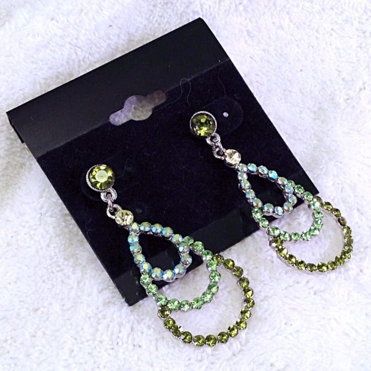 Olivine crystals with ab accent stones on small chandelier earrings aloadofball Gallery