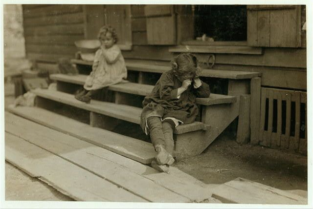 """The little 5 yr. old after a day's work that began about 5:00 A.M. helping her mother in the Biloxi Canning Factory, begun at an early hour, was tired out and refused to be photographed. The mother said, """"Oh, She's ugly."""" Both she and other persons said picking shrimp was very hard on the fingers. Biloxi"""