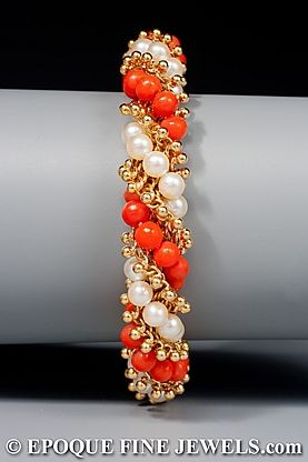 Van Cleef & Arpels - An 18 karat gold, pearl and coral torsade bracelet,
