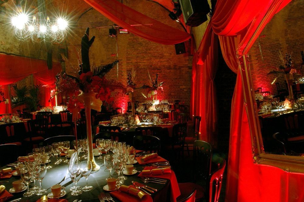Moulin rouge and burlesque themed venue decor and table for Burlesque bedroom ideas
