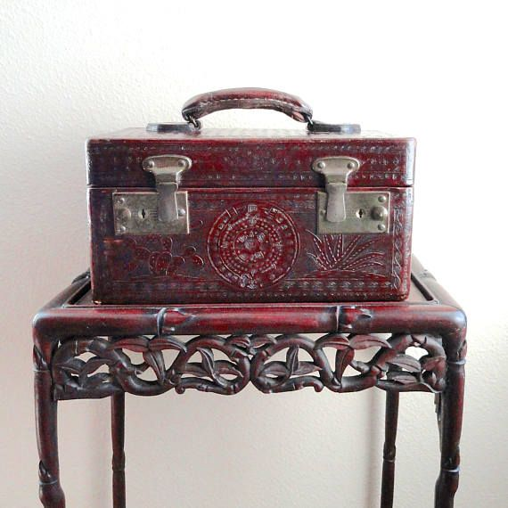 Vintage Tooled Leather Train Case, Chestnut Brown, Made in Mexico 1940s  This rustic and worn tooled leather train case has a truly bohemian character and history. This case went on many artistic travels to Mexico and back. In its second life, it became a tote for ballet and dance class. Its waiting for another journey with a new owner - maybe you?  SIZE: 12 in length; height 6; width 7 HANDLE: strong, solid and thick EXTERIOR: Vintage aged; ornate embossed decorations; great character…