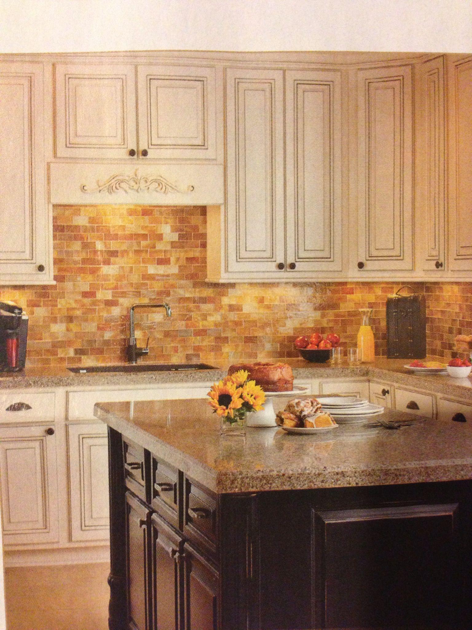 antiqued white cabinets black island multi toned neutral backsplash decorative panel above - Multi Kitchen Ideas