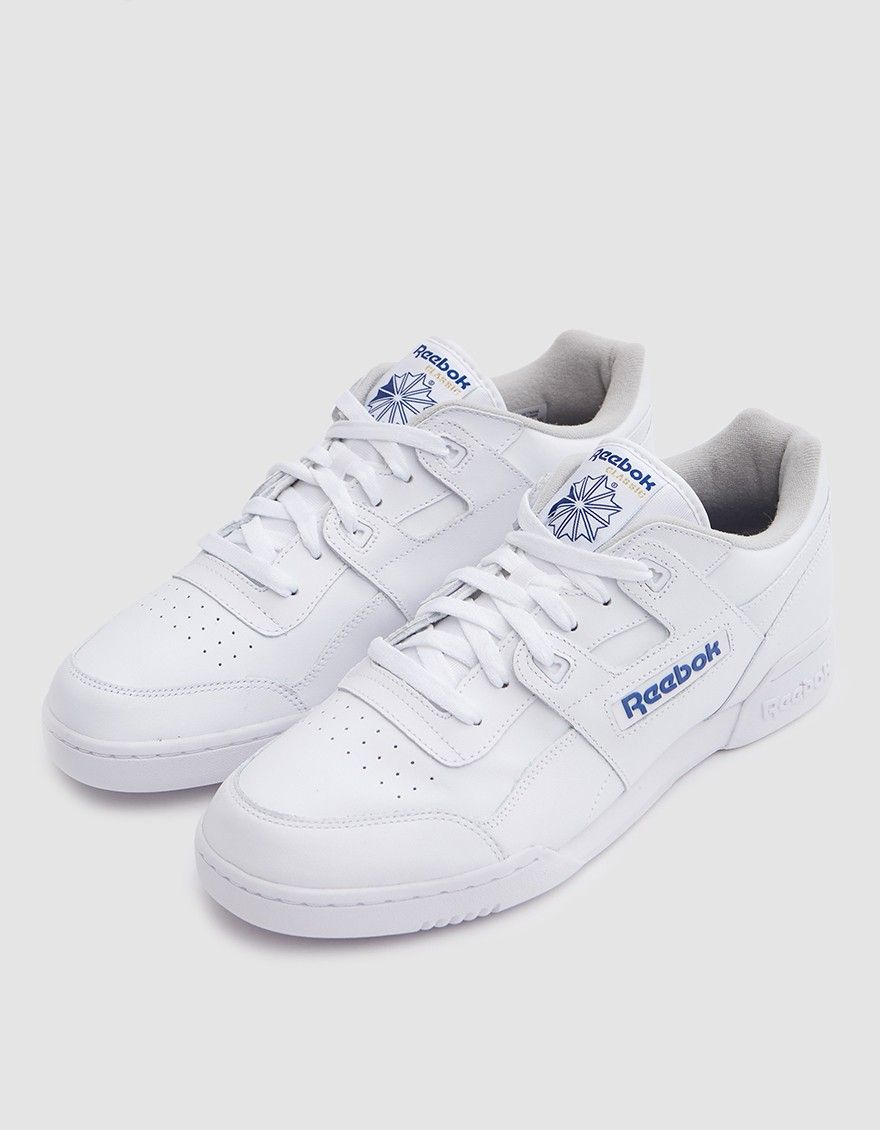 Classic trainer from Reebok in White and Royal. Soft full grain leather  upper. Lace-up front with flat woven laces. Lightly padded collar. Iconic H- strap at ... e4f37a9a1