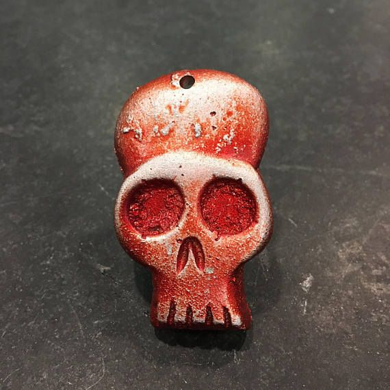 Red Skull *I am now offering this item with an optional two hanging bones, which increases the price by ten dollars. The bones finish will match the skull. You must select the skull with two bones option in the style drop down, if you want the bones to be included. For any other potential customization requests, please contact me before placing an order. If you like skulls as much as I do, I think you will be very happy with this one.  This is a hand made item that I designed and carved in…