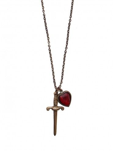 Distressed gold tone chain necklace that features dagger and red heart charms