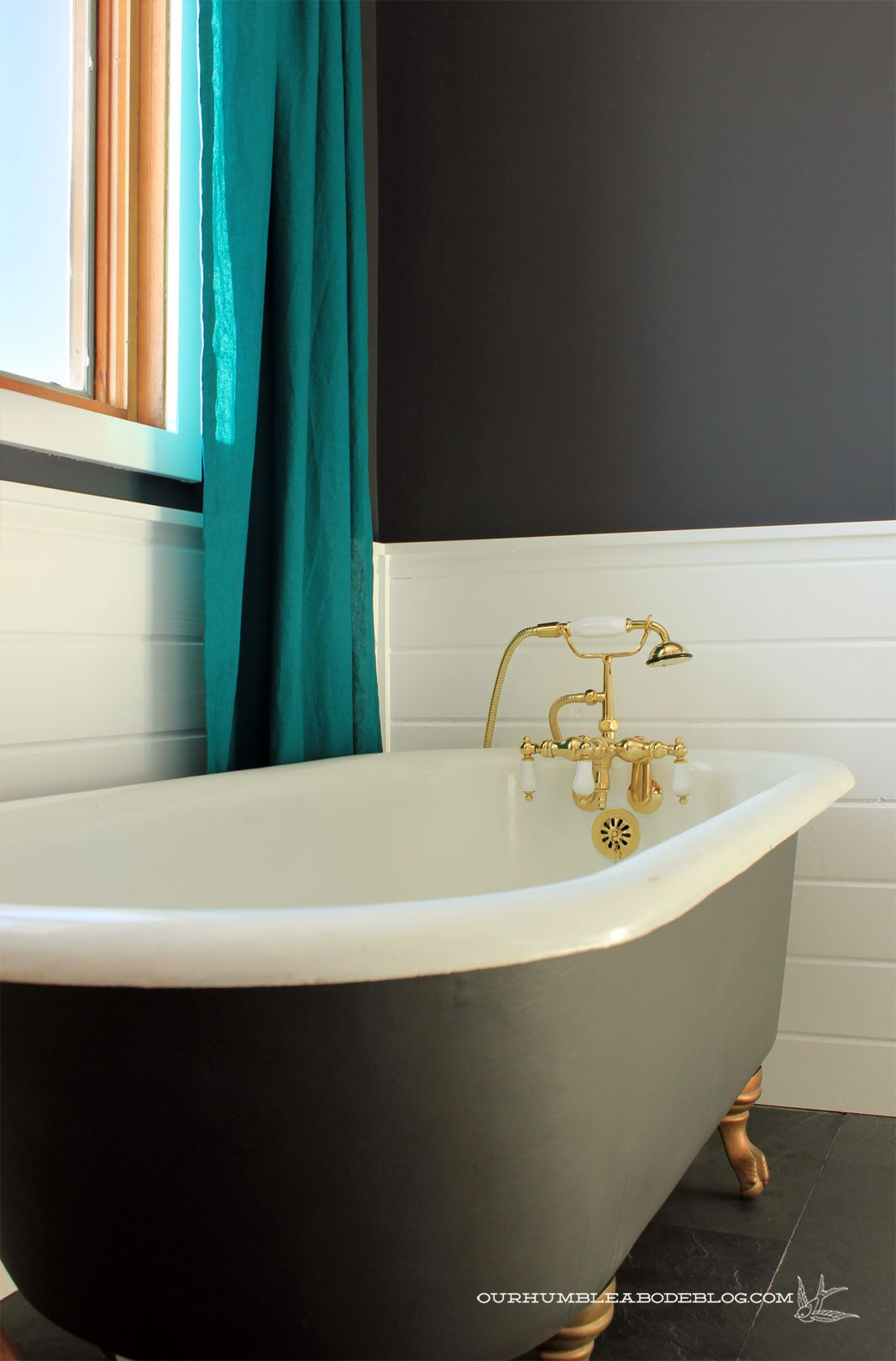 Teal Curtains And Black And White Claw Foot Tub With Gold