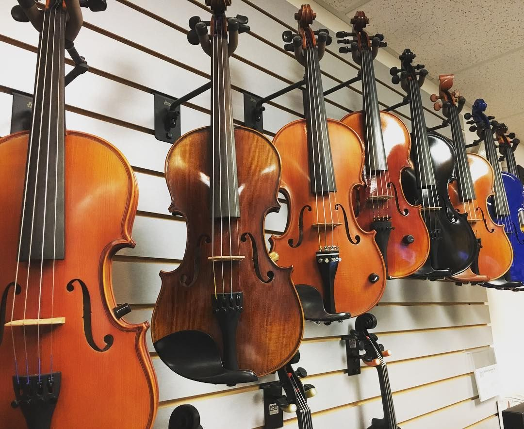 A Rack Of Acoustic Electric Violins Acoustic Electric Violins