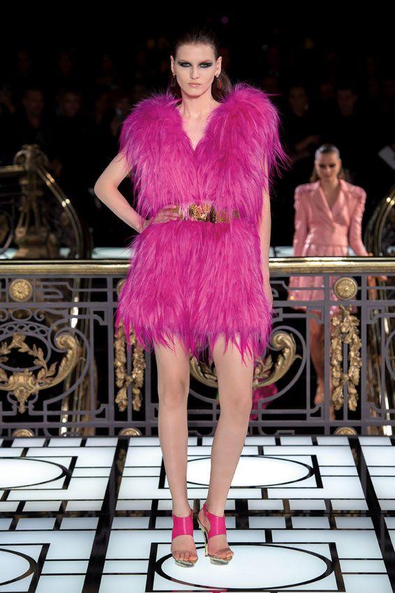 Fluorescent pink fox fur gilet, woven by hand. A gold chain belt ...