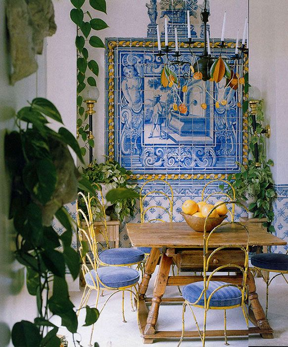 A beautiful tile mosaic is the focal point in a dining area by designer John Oetgen.