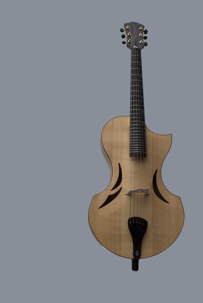 Marc De Waey Makes Some Guitars In The Style Of Other Instruments Here S One That Resembles Violin Construction It Jazz Guitar Guitar Design Acoustic Guitar