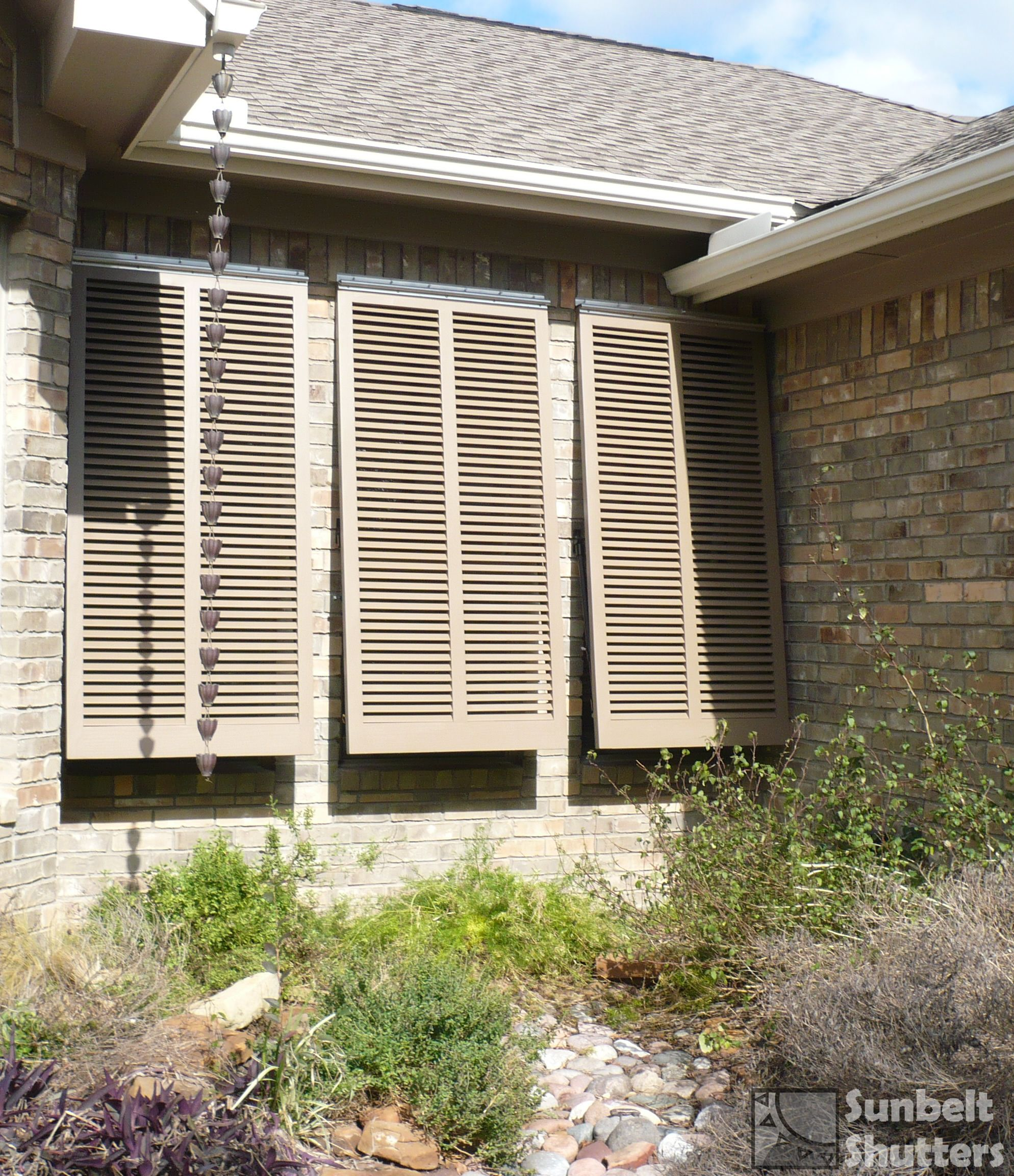 Cedar bahamas shutters with open louver style louvers at a 45 degree angle installed with for Exterior louvered window shutters