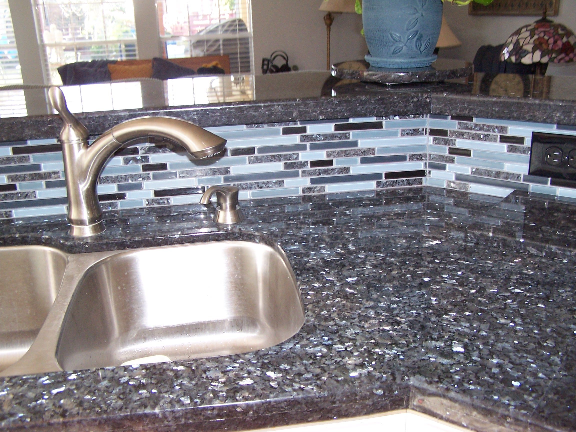 Blue pearl granite with matching backsplash this is going in my house in a few weeks