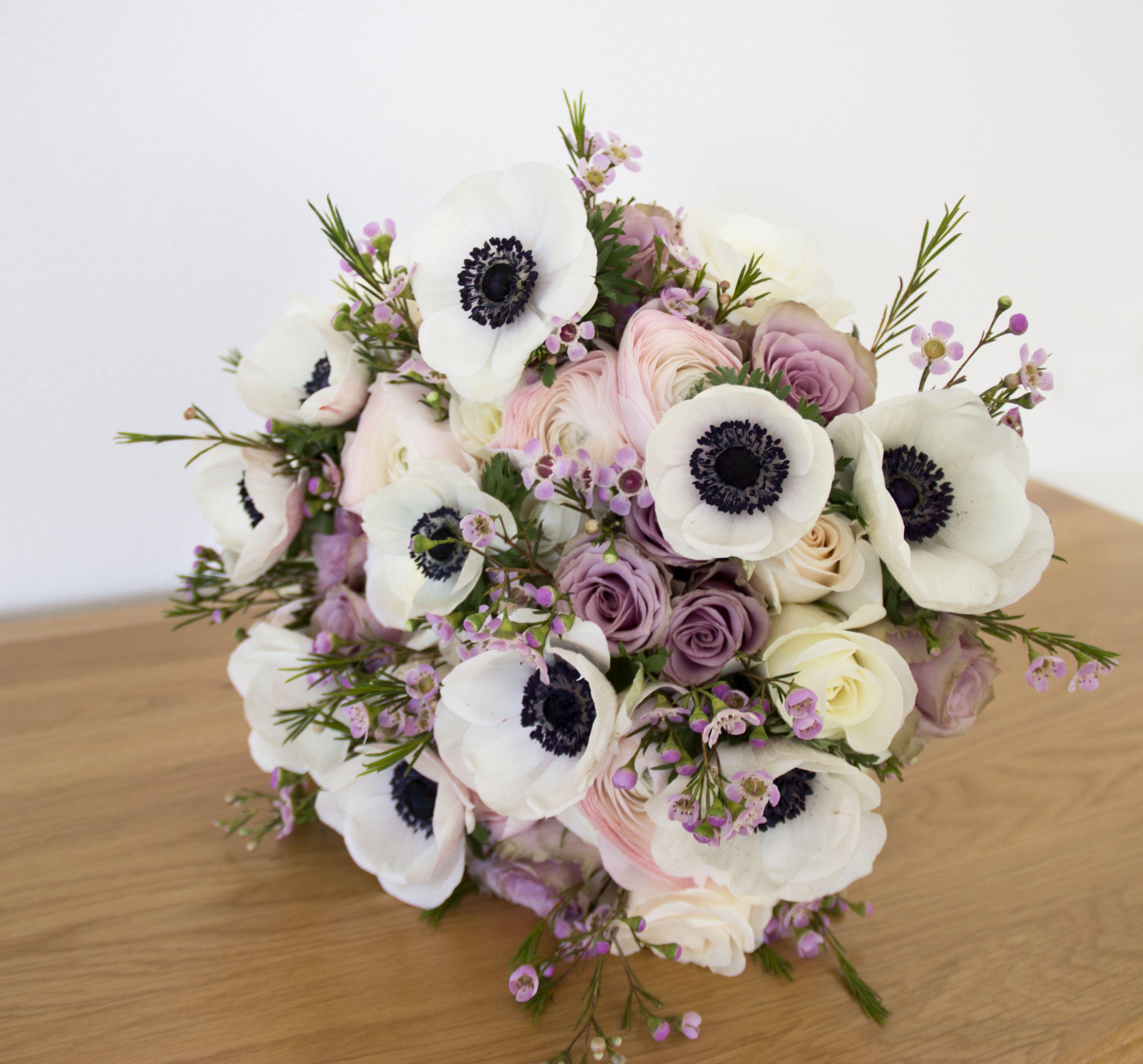 vintage romantic white pink winter spring wedding bridal bouquet with anemones ranunculus