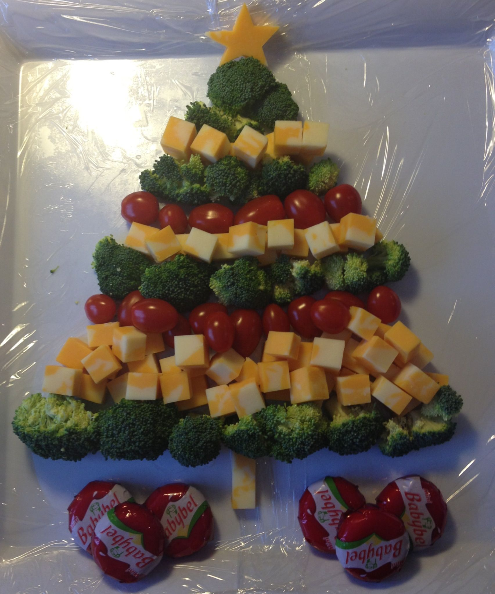 Christmas tree cheese platter with broccoli and cherry tomatoes. Perfect for Christmas party!