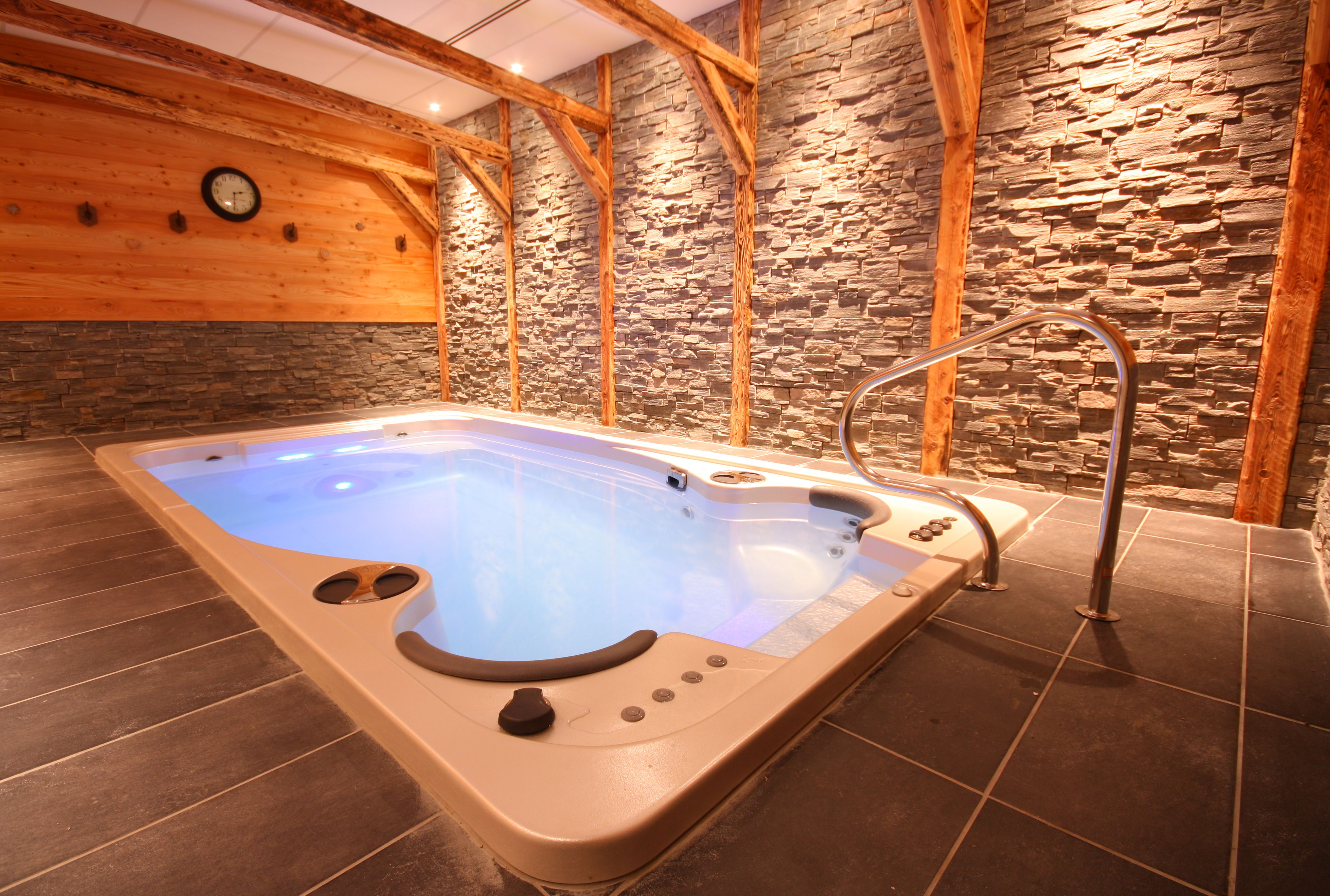 Hydropool self cleaning swim spa installed indoors for Pool builder quotes
