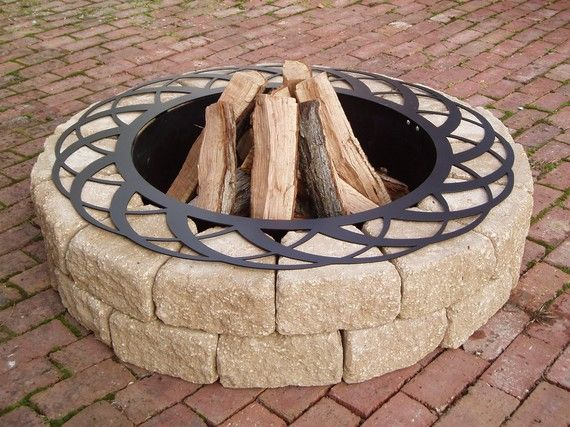 Fire pit.  I can fit the store bought one inside a structure that I build... hhhmmmm.