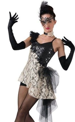 b4097254acc Black sequin swirl lycra and ivory hologram lace tunic with attached black  lycra shortie unitard. Attached black mesh side bustle and ruffle sleeve.