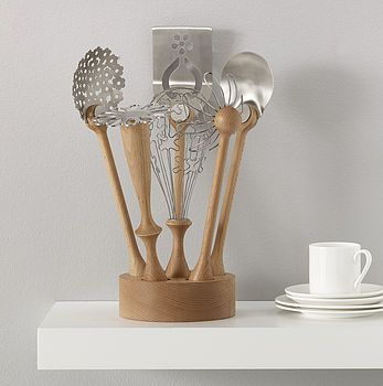 Wild Flower utensil set by Bojje.  The set is comprised of the 'Yarrow' skimmer, the 'Daisy' masher, the 'Sorrel Petal' serving spoon, the 'Bluebell' scoop, the 'Buttercup' whisk, the 'Rag' spaghetti spoon.
