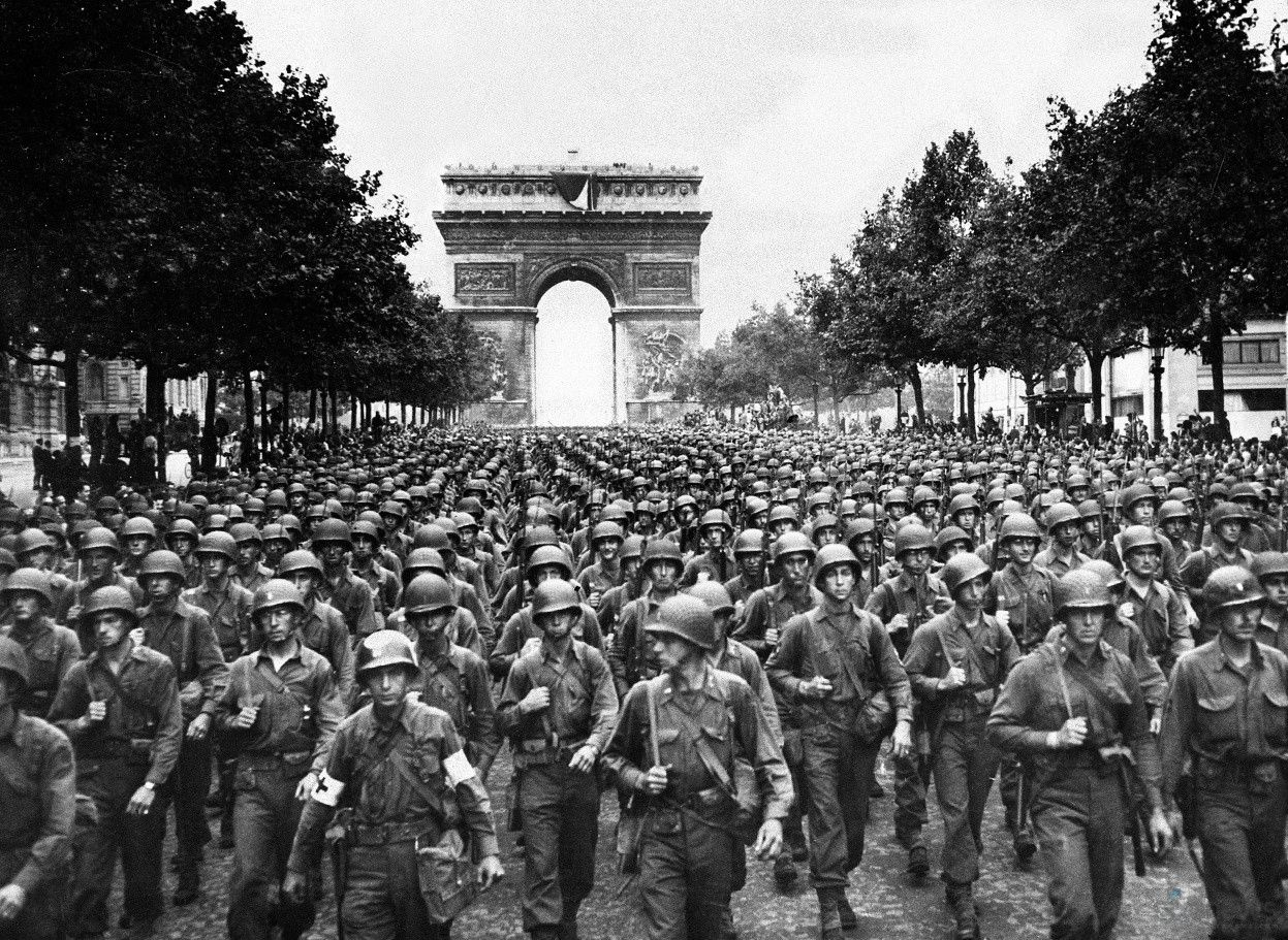 Soldiers of the 28th Infantry Division parade down the Champs-Élysées in Paris on August 29, 1944. The division was the first American division to enter the capital after its liberation. The 28th is the oldest Division in the US military and is known as the 'Iron Division'.