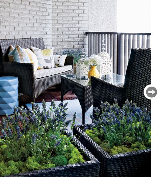 A Diy Outdoor Rug Wood Slat Flooring And Faux Greenery Warm Up This Brick