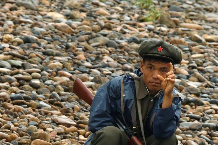 Northkoreanucleara north korean soldier keeps watch at