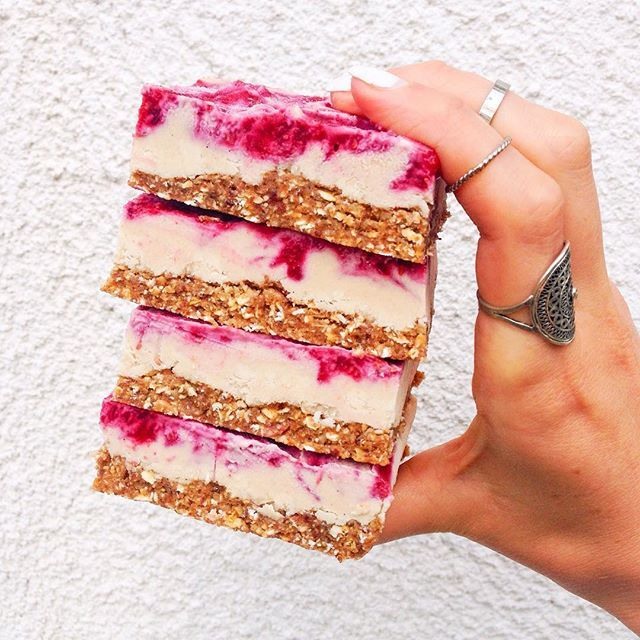 Raw vegan frozen coconut cheesecake bars with raspberry swirl topping and cinnamon pecan crust. These bars taste like cheesecake ice cream but are sneakily healthy enough for breakfast. My entry for the #frostyfrozenfoodfest hosted by these lovely ladies! @flourishinghealth @tumblinbumblincrumblincookie