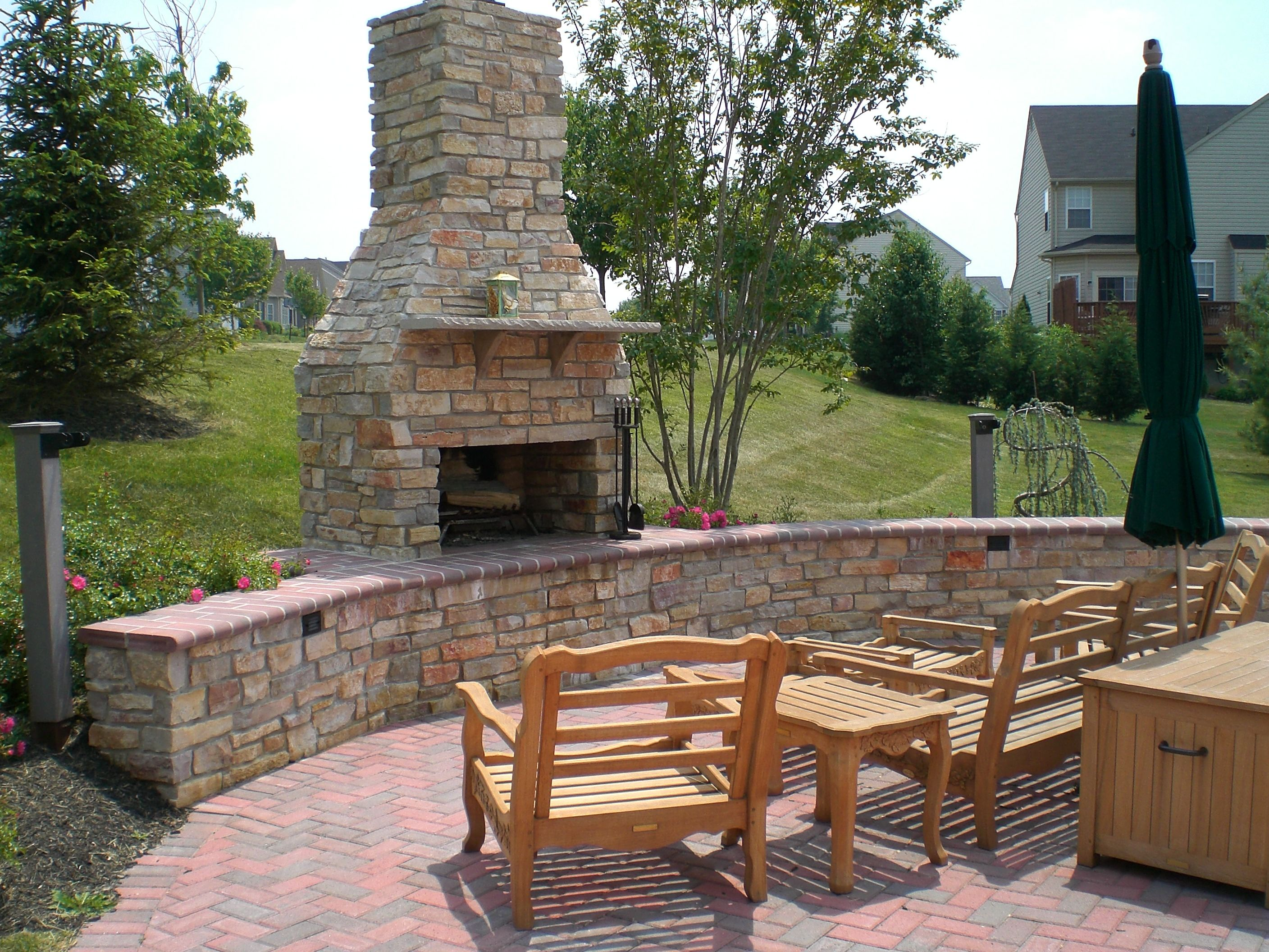 outdoor patio and fire place ready for use another quality job